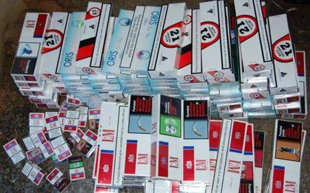 Depistat şi reţinut de poliţişti pentru contrabandă cu ţigări